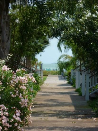 The boardwalk between the houses with Aransas Bay in view