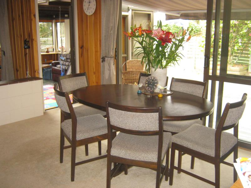 Dining room with Bifolds out on to the deck and back yard - very private and sunny.