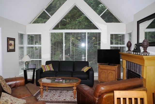 Bright and airy air-conditioned living room with vaulted ceilings