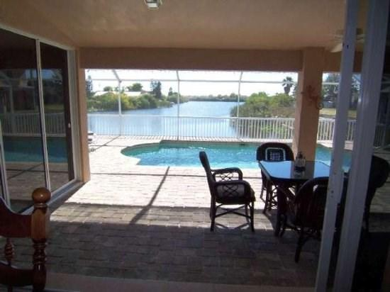 Villa Lucy - Cape Coral electric heated Pool Home with 3 bedroom/2 bathroom on a wide fresh water canal - Image 1 - Cape Coral - rentals