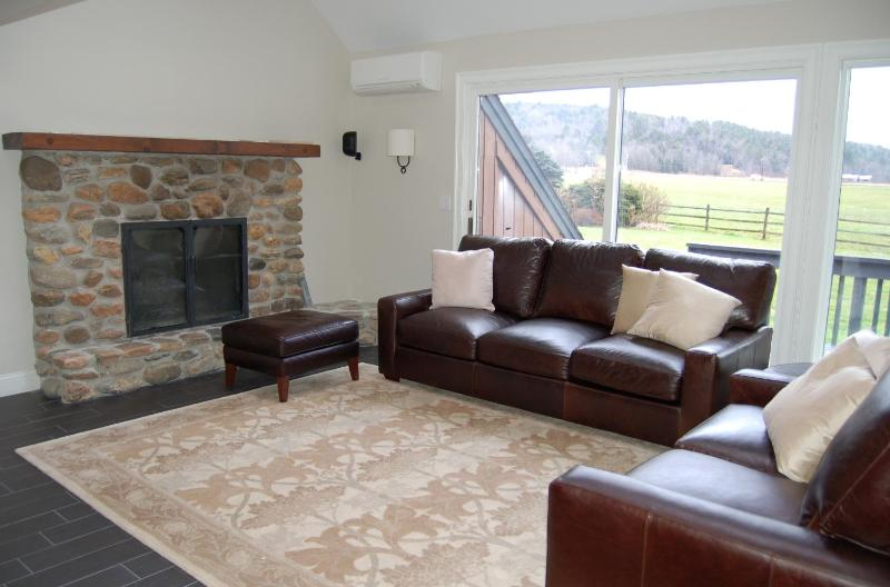 FAMILY ROOM WITH FIREPLACE AND PLASMA TV HAS MOUNTAIN VIEWS