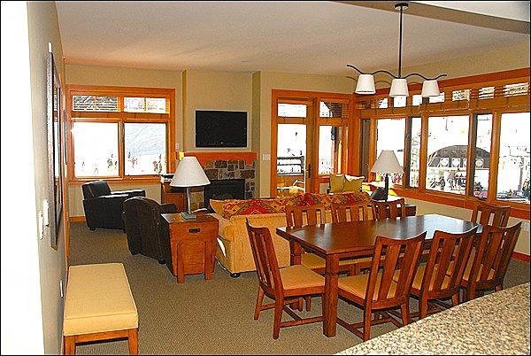 Large open living area with views of the slopes, Gondola, and Village Express