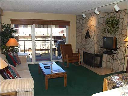 Nicely appointed living room with gas fireplace