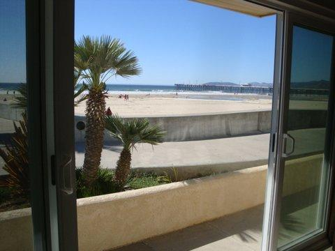 Sliding glass door in living room~opens up to the beach!