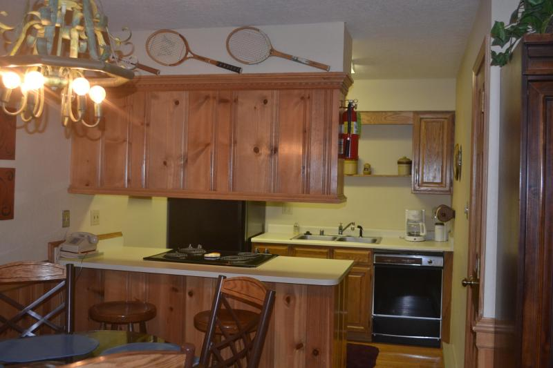 Complete kitchen with stove/oven, dishwasher, refrigerator/freezer & pots/pans, utensils & dishes