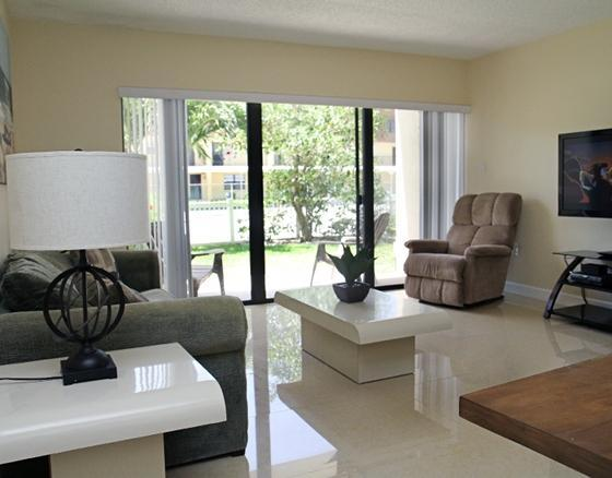 Bright and Open Living Room (Pullout Couch, Walk out to Patio, 52' LCD TV, BluRay)