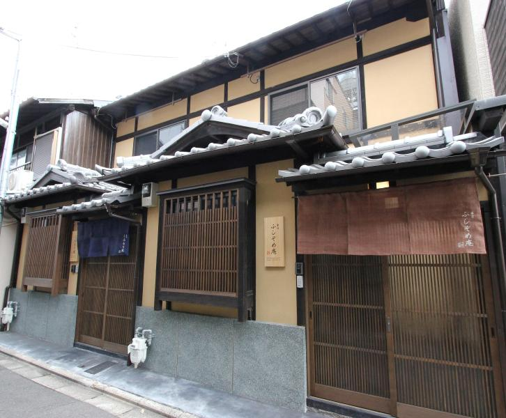 Two separate machiya townhouses are located next to each other.