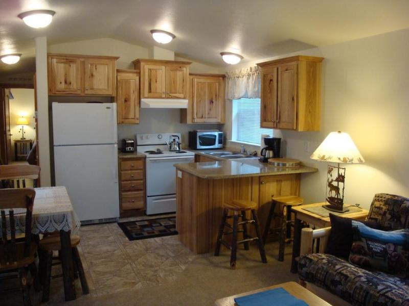 Kitchen with hickory cabinets all dishes; appliances; pots pans etc