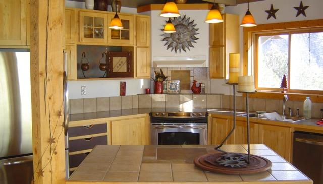 The gourmet kitchen has stainless appliances, an island, a walk-in pantry & a window over the sink.