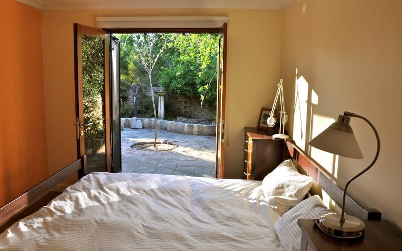bedroom with access to front court yard