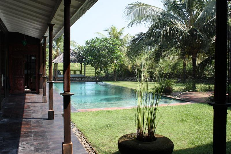 Spacious living room opening onto your private pool and tropical lush garden