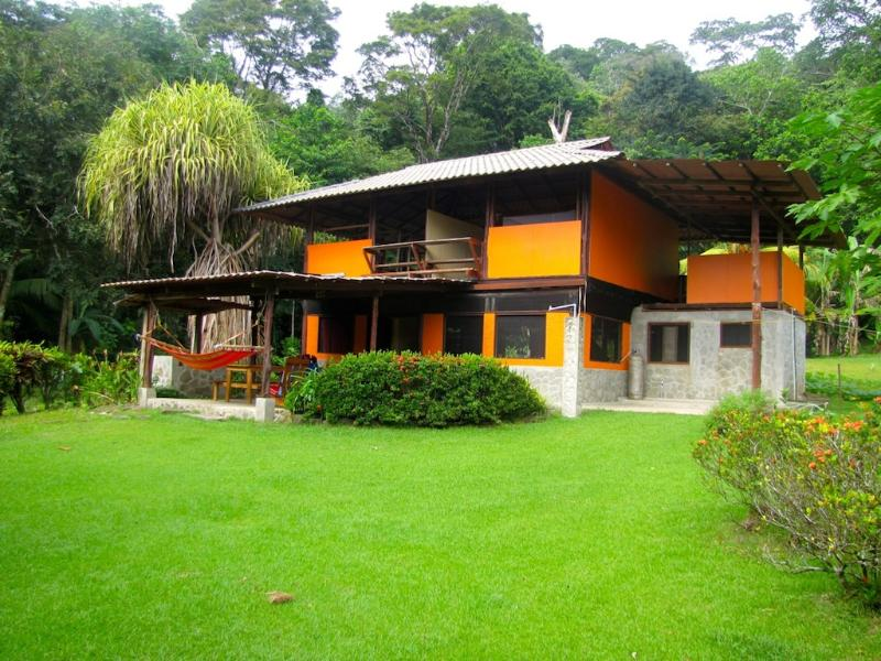 The home sits amongst acres of tropical gardens.