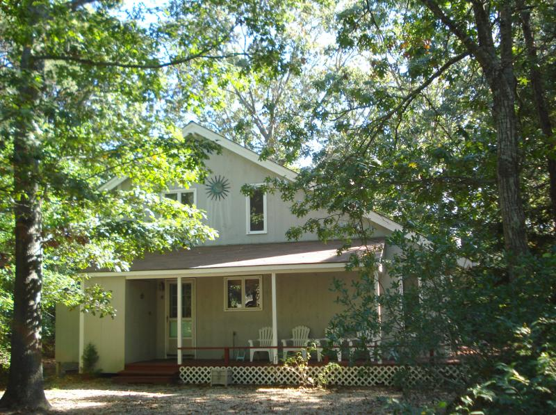 Secluded on a wooded lot on paved road