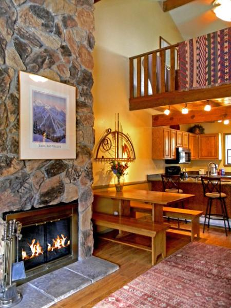 2nd floor living room, dining, kitchen with 2 story granite boulder wood burning fireplace, 3rd story loft
