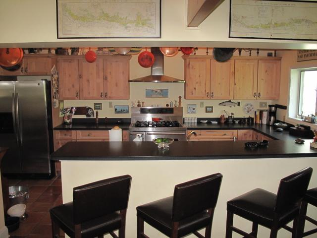 Chef's kitchen. Five-burner stove, side warming oven. Breakfast counter for 4.