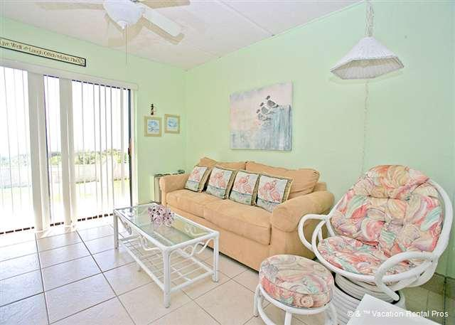 The bright and cheery living room, with sweeping sea views!