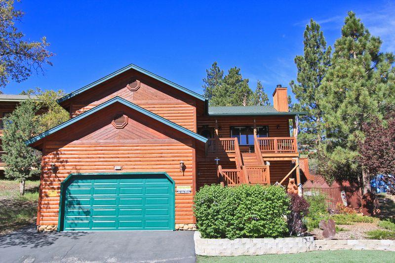 An amazing three story log style home with four bedrooms and three and a half bathrooms.