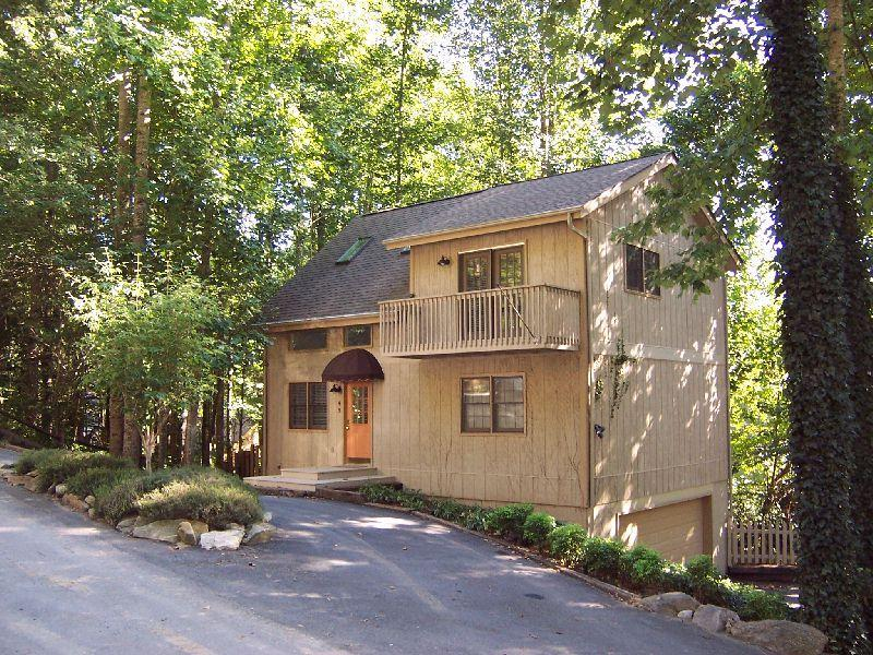 Two story home tucked into treed area.  Quiet but convenient.  Easy access