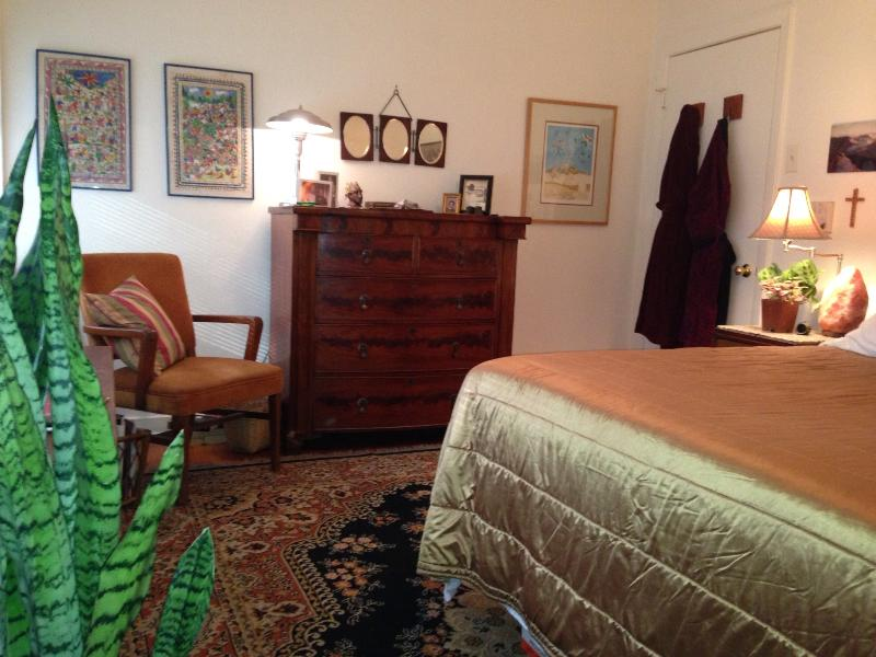 Your room is beautifully furnished  with antiques, plants, and art