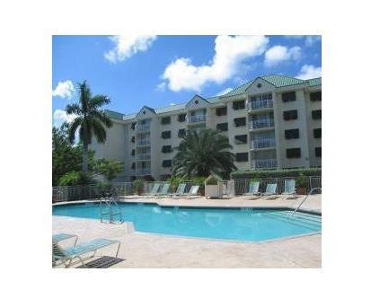 Front of the condo and its pool and hot tub.
