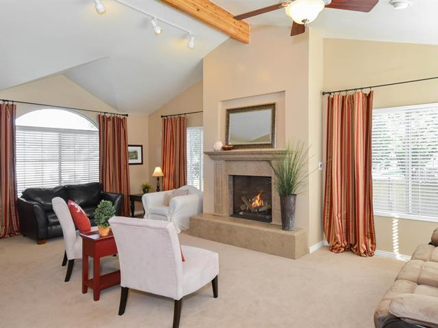 Spacious living room with fireplace and vaulted ceiling