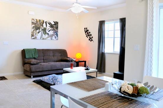Spacious living room area with a sofa bed and Loft style dinning room