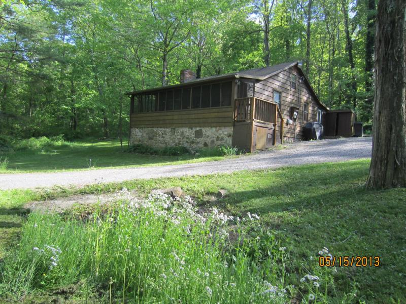 Front View of Cabin in Spring