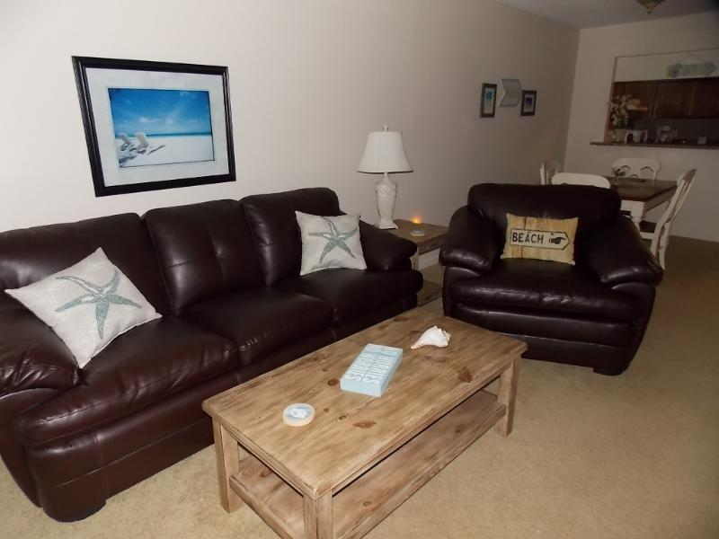 Cozy Living Room with leather sleeper sofa and leather chair