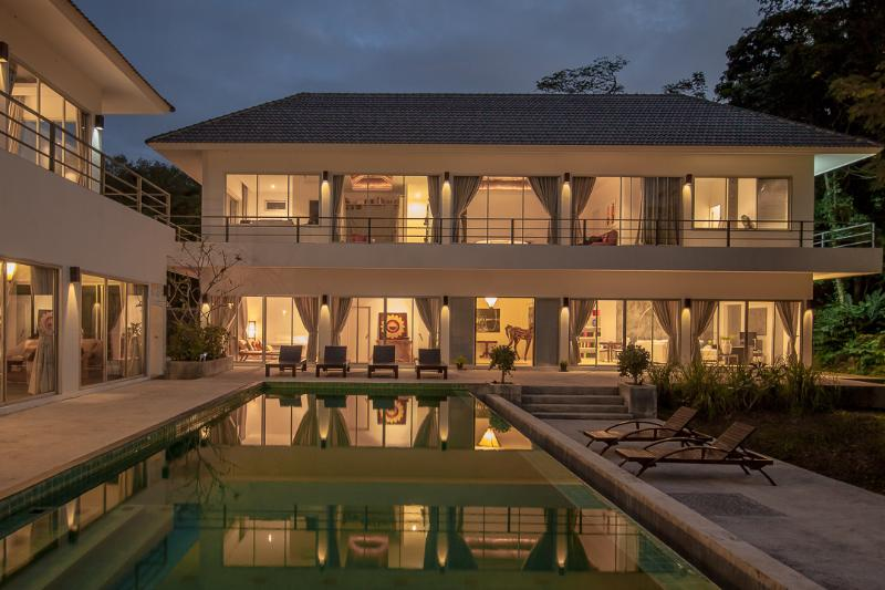 Beautiful night view of the villa at dusk.