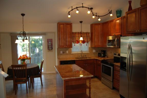 Modern kitchen with Stainless appliances, granite counters and tile flooring