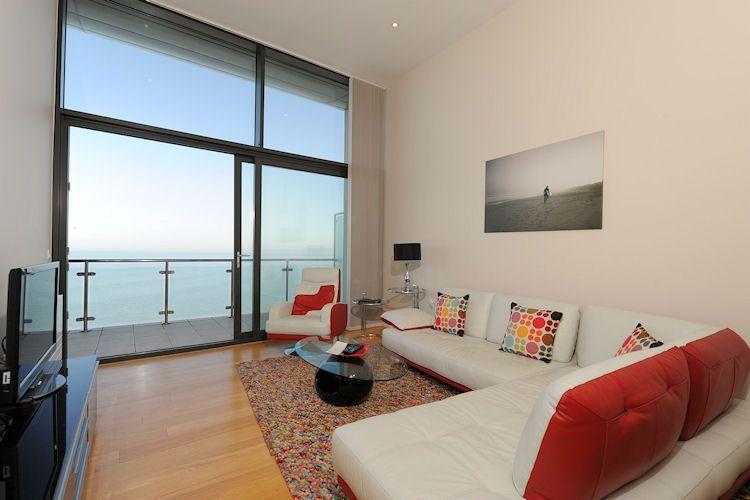 Living area leading to the balcony with sea views