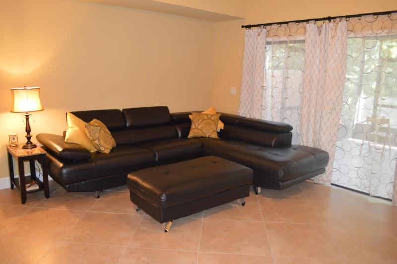 Living room - extends into lanai under roof
