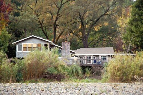 This home's location on the river's edge gives spectacular views from the deck