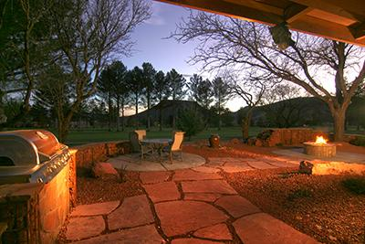 Patio at night with firepit.
