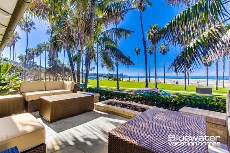 Oceanfront view patio at La Jolla Shores with lounge seating and fire pit