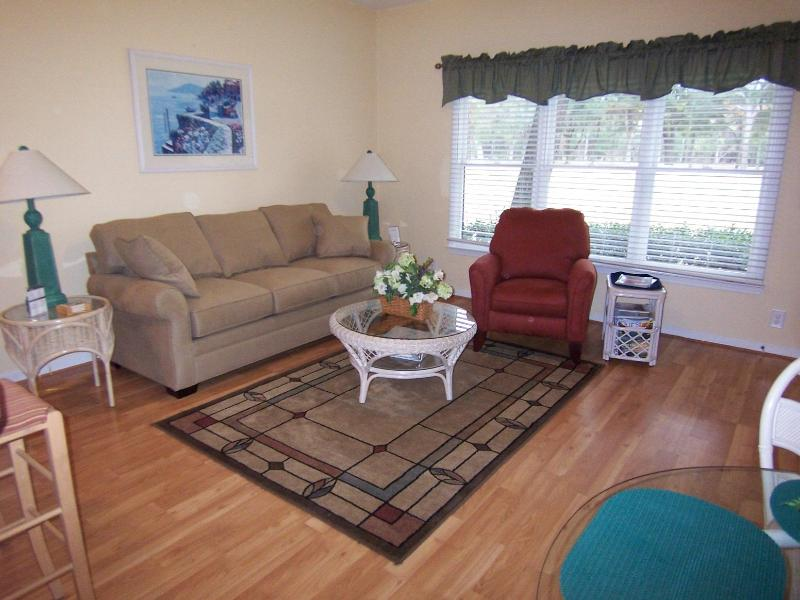 Ground floor living area with large screen TV and comfortable furniture