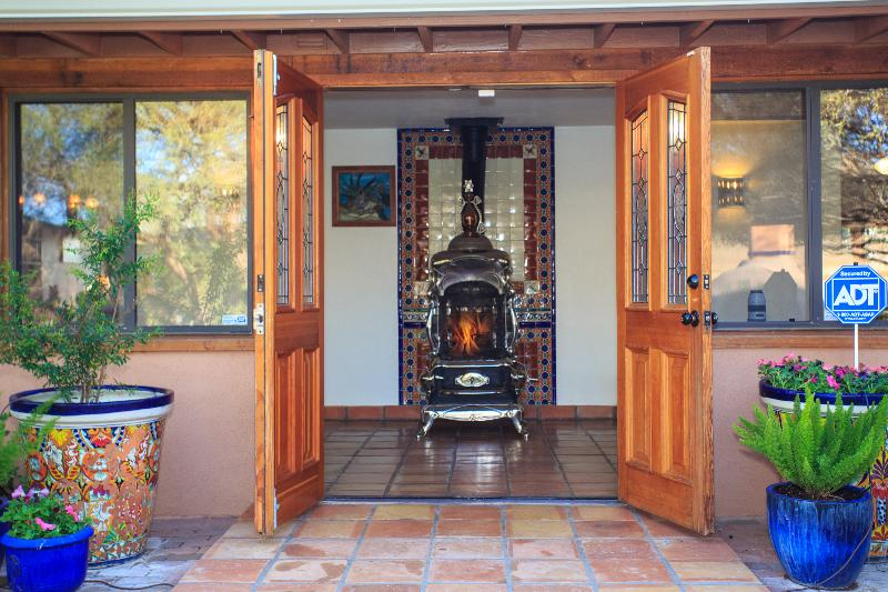 Parlor stove in foyer greets you.
