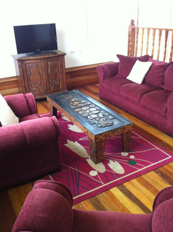 Living Room area highlighting hardwood flooring made with a variety of exotic wood