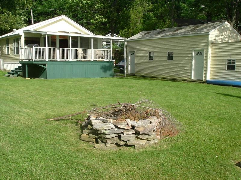 Shot of cottage and boathouse, also firepit