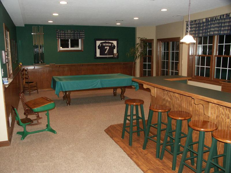 Basement with wetbar and pool table