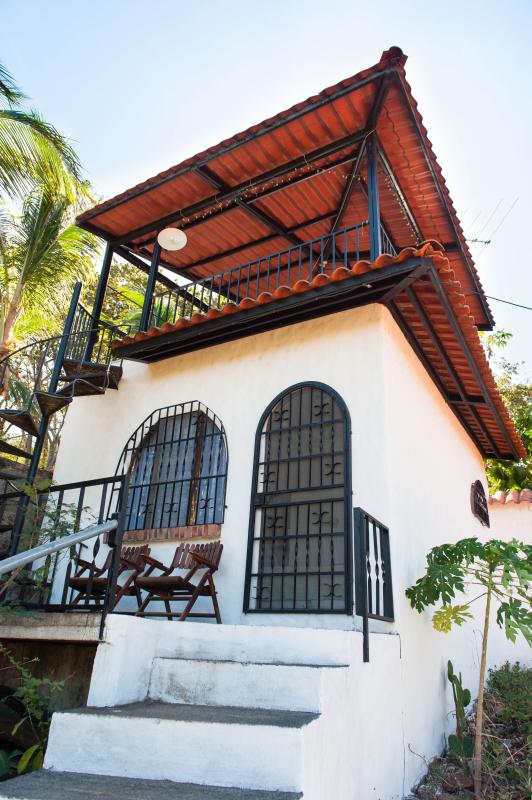 Cabina with siting area in front and private tower patio above