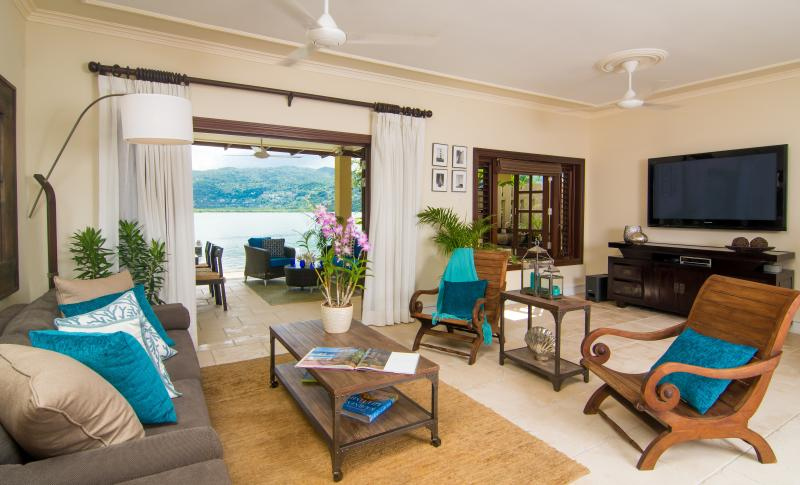 The beautiful living room with view to back patio