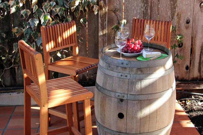 Wine barrel bar under shaded arbor