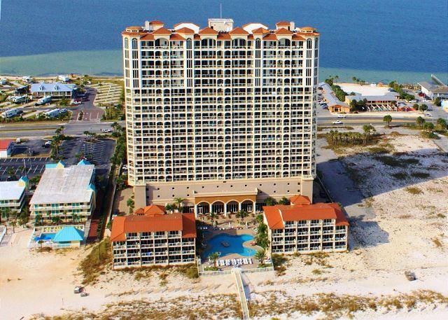 This Gulf front luxury condominium offers a spa, fitness center, swimming pool and hot tub.