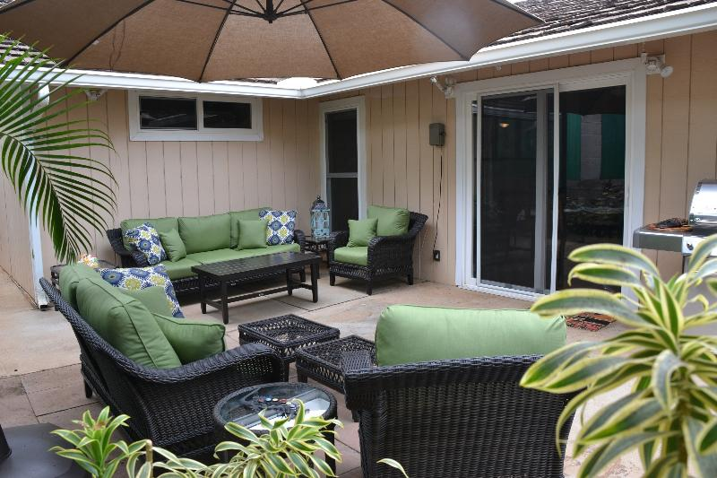 Relax on your private lanai surrounded by the beautiful garden