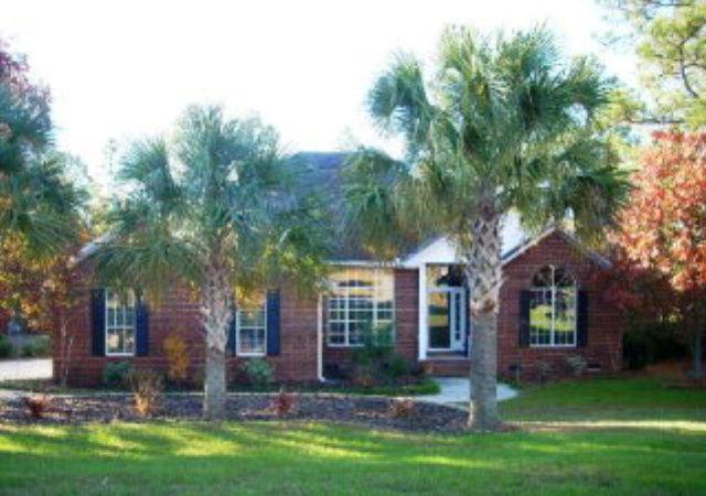 Front view features palmetto trees