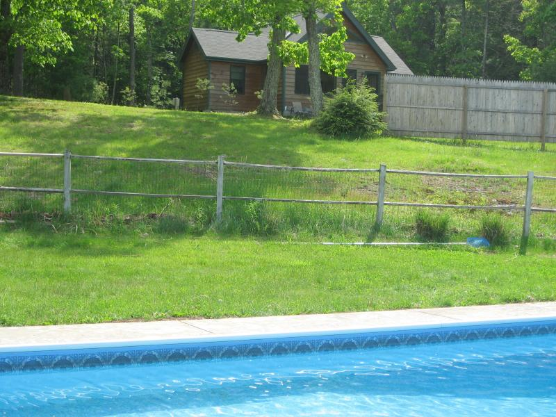 view of  Sunset cottage  & acreage from pool