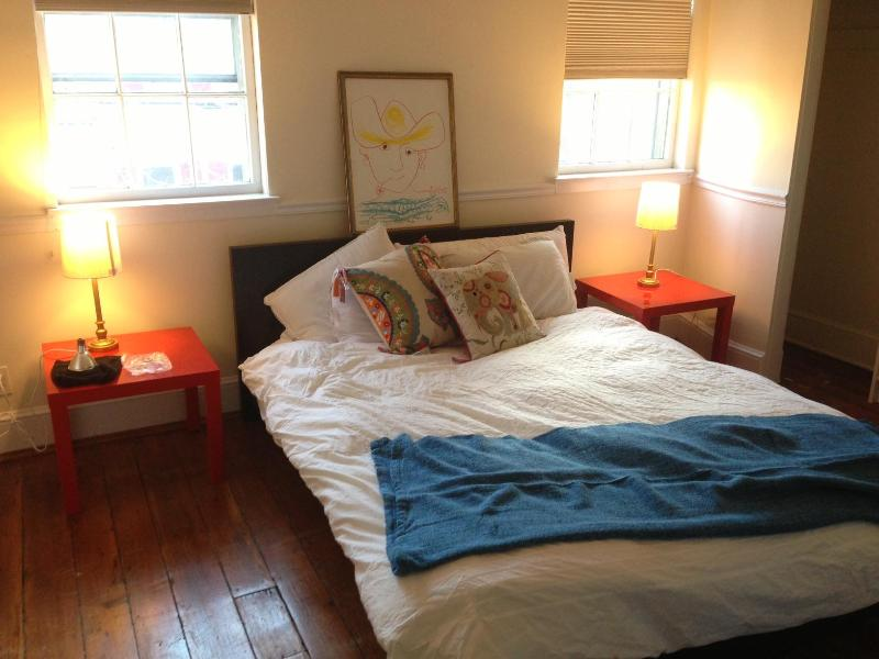 The Picasso Room has a queen bed and is comfy, cheery, and colorful!