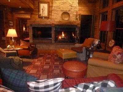 charming living room with a wood burning fireplace