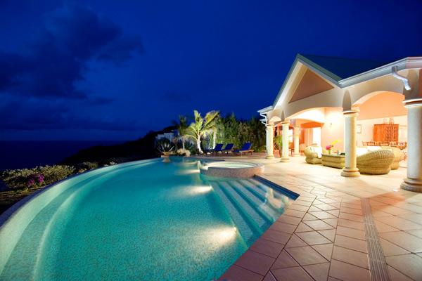 Villa by night on pool side and sunset